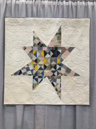 Homespun by Mary Kerr, Quilted by Donna Ferrill James. The star was created from a worn vintage quilt top.