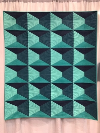 Dimension by Nydia Kehnle. Quilted by Gina Pina.