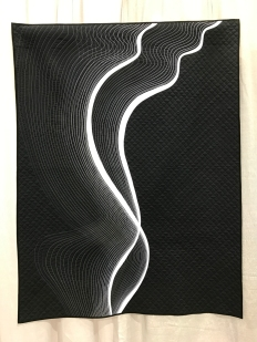 Smoke by Katherine Jones. Inspired by a wisp of smoke. Two strips of white bias applique, echoed, by quilting in decreasing thicknesses of thread.